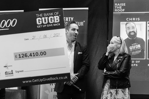 dan atkins accepts cheque for Busses 4 homeless